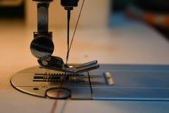 Sewing machine needle stock photos