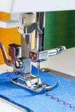 Sewing machine, needle and cloth. Close-up on table Stock Images