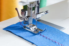 Sewing machine, needle and cloth. Close-up on table Stock Photo