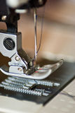 Sewing Machine Needle and Foot up close. Focus is on the point of the needle stock photos
