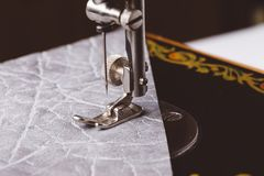 Sewing machine needle with leather. In the process of sewing Stock Photos