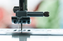 Sewing machine needle. Sewing machine macro view of the needle mechanism Royalty Free Stock Image