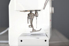 Sewing machine ,needle and presser foot. A close up of a sewing machine and the presser foot and needle Stock Photo