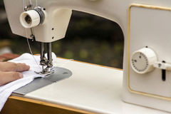 Sewing machine. Needle and sew the fabric Royalty Free Stock Photography