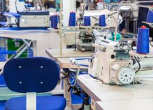 Sewing machine, nobody, clothing sew on fabric. Factory production, cloth manufacturing, dressmaker workplace Stock Image