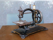Sewing machine. Old vintage sewing machine with blurred background Stock Images
