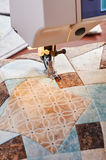 Sewing machine with patchwork block of quilt Royalty Free Stock Photo