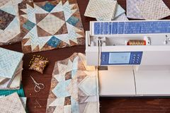 Sewing machine with patchwork block of quilt Stock Photo