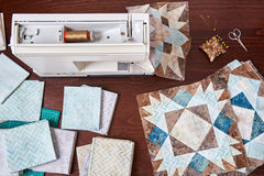 Sewing machine with patchwork block of quilt Royalty Free Stock Image