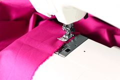 Sewing machine and a pink fabric Stock Photography