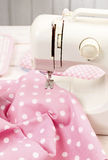 Sewing machine and pink fabric Royalty Free Stock Photo