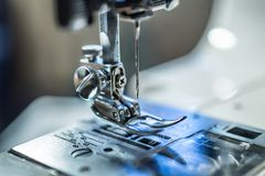 Sewing machine presser foot with needle. Close-up stock photography