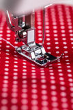 Sewing machine presser foot. With threaded needle Royalty Free Stock Photo