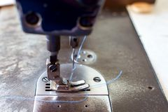 Sewing machine in sewing process.  stock images