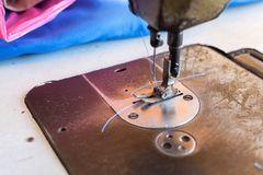Sewing machine in sewing process.  royalty free stock photo