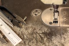 Sewing machine in sewing process.  stock photo