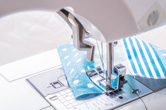 Sewing machine process Stock Photos