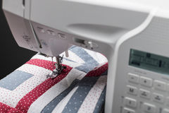 Sewing machine with quilt Stock Photos