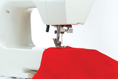 Sewing machine with a red fabric. Closeup Royalty Free Stock Photo