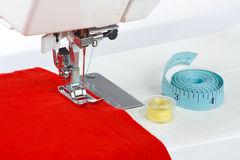 Sewing machine with a red fabric. Closeup Stock Images