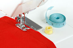 Sewing machine with a red fabric. Closeup Royalty Free Stock Photos