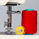Sewing machine and reels with thread. Macro image of a sewing machine and reels with thread Royalty Free Stock Photo