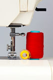 Sewing machine and reels with thread. Sewing machine and reels with colorful  thread Royalty Free Stock Image