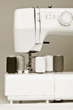Sewing machine and reels with thread. Monochromatic image of a sewing machine and reels Stock Image