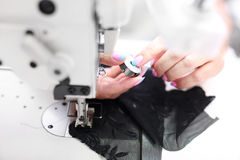 Sewing on a machine Royalty Free Stock Images