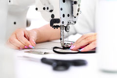 Sewing on a machine Royalty Free Stock Image