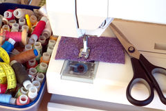 Sewing machine and sewing accessories closeup Stock Image