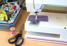 Sewing machine and sewing accessories closeup Royalty Free Stock Photos