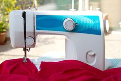 Sewing machine and silk cloth Royalty Free Stock Photos