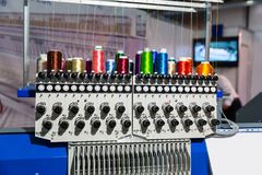 Sewing machine with spools of thread closeup. Professional sewing machine with spools of thread closeup. Textile fabric, nobody. Factory production, sew Royalty Free Stock Photos