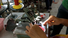 Sewing machine stitching on textile stock footage