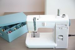 Sewing machine on table in tailor`s. Workshop Royalty Free Stock Photography