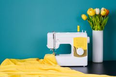 Sewing machine on table in workshop. Sewing curtains stock photos