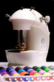 Sewing machine. Tailoring set with different colored spools and scissor Stock Images