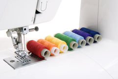Sewing machine and thread. Sewing machine and a set of reels with thread Stock Photo