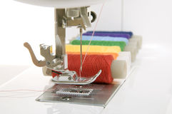 Sewing machine and thread. Sewing machine and a set of reels with thread Royalty Free Stock Photos