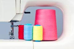 Sewing machine and  thread bobbins Stock Images