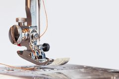 Sewing machine with thread in needle background royalty free stock photography