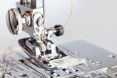 Sewing machine with thread in needle close-up royalty free stock image