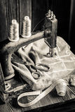 Sewing machine with threads, scissors and cloth Stock Photo