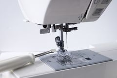 Sewing Machine With Tool Of Screwdriver. Royalty Free Stock Photography