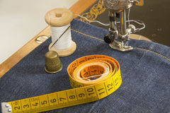 Sewing machine and tools. Sewing machine and item of clothing material Royalty Free Stock Image