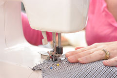 Sewing machine in use with focus on pressure foot Royalty Free Stock Photo