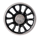 Sewing Machine Wheel. Wheel of an antique sewing machine stock photo