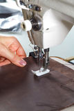 Sewing machine with womans hands Royalty Free Stock Photography
