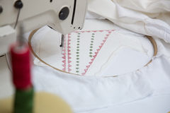 Sewing machine during work. With red and green thread doing traditional sticking Stock Photo